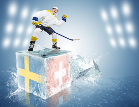 Spunky hockey player on ice cube of Sweden - Switzerland game