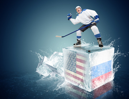 spunky: Spunky hockey player on ice cube of USA - Russia game Stock Photo
