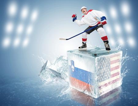 spunky: Spunky hockey player on ice cube of Slovenia-USA game Stock Photo