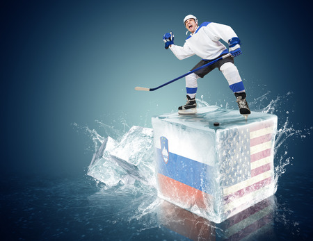 Spunky hockey player on ice cube of Slovakia-USA game photo