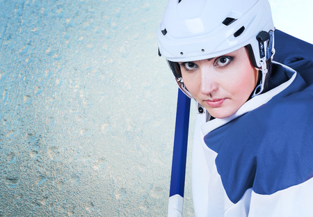 girl models: Beautiful ice hockey female player fashion portrait on the ice background