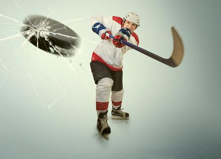 Ice hockey puck hit the opponent visor photo