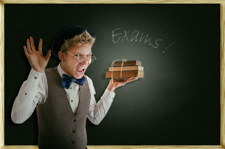 Exams soon  Terribly screaming student with books photo