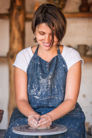 Woman work on potter Stock Photo