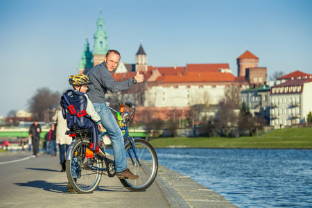 Walk on bike  Father with son cycling in city photo