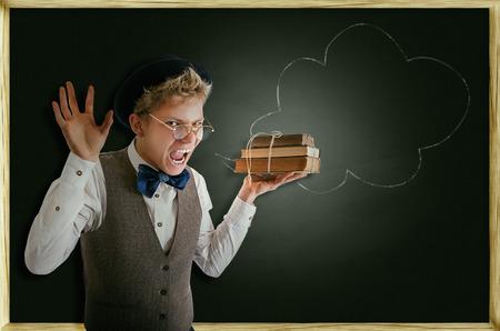 terribly: Exams soon! Terribly screaming student with books Stock Photo
