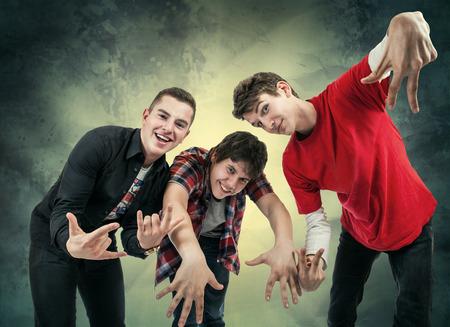 urban dance: Three young man in fun hip hop poses