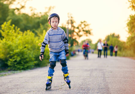 Little roller skater in the evening park  photo
