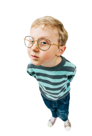 egghead: What are you doing here? Little pretty boy curios portrait Stock Photo