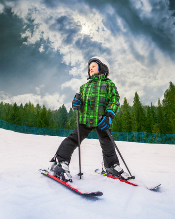 Little skier in mountain sky resort photo