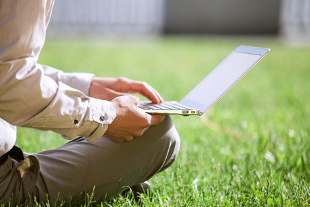 close up image: Close up image man hands on laptop keyboard