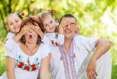 Fun family leisure  Little daughters plays with their parents photo