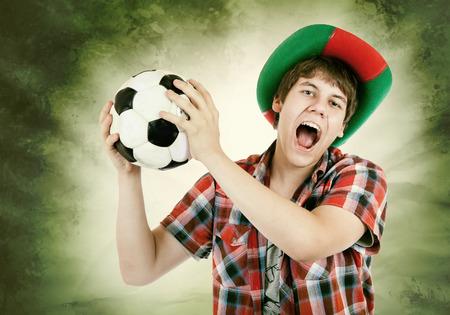 loudly: Portuguese fan loudly shouts on the Brazilian colors background