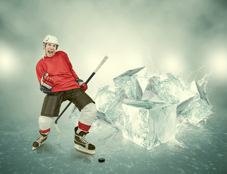 ice hockey player: Screaming hockey player on abstract ice background