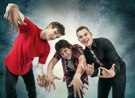 yo: Three young man in fun hip hop poses