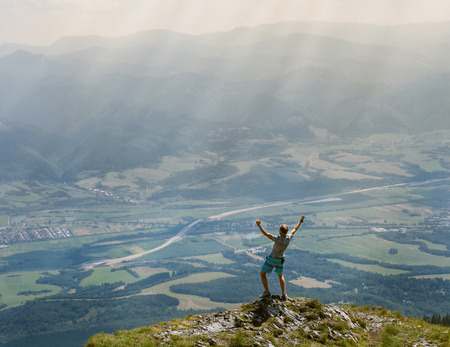 masters of rock: Extreme runner finally climbs the mountain top and see wide valley