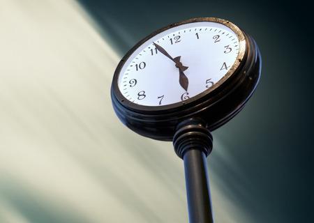 Big street Clock on the blurred sky background photo