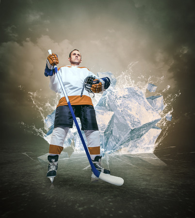 Hockey player portrait on abstract ice background photo