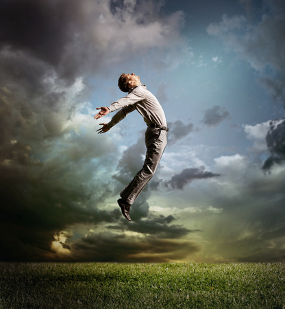 Jumping man in sky photo
