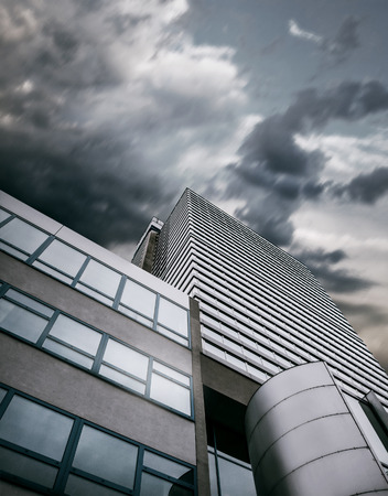 wind storm: Modern office center building with apocalyptic sky