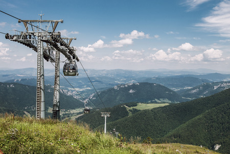 top down car: Ski resort at summertime. Ski lift waiting for winter