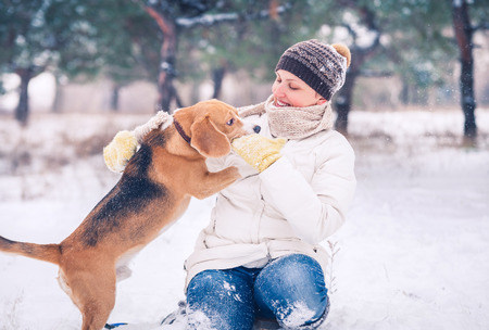 Woman with her pet has winter active leisure time Stock Photo