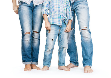 tattered: Family legs in tattered jeans