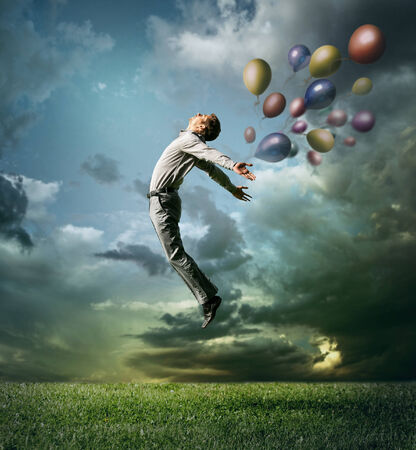 Man jumping up to Sky wit color bright balloon photo