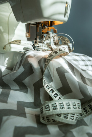 sartorial: Taylor workplace: sewing machine , fabric and sewing meter