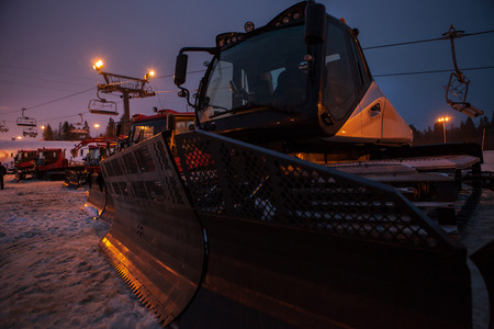 snow grooming machine: Snow groomers sleeping after the hard day on the Snow Ski Resort Stock Photo