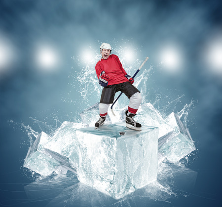 Screaming hockey player on abstract ice cubes background photo