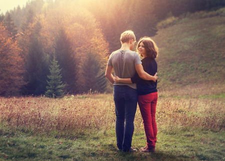 inlove: Two inlove young people on the sunset forest glade