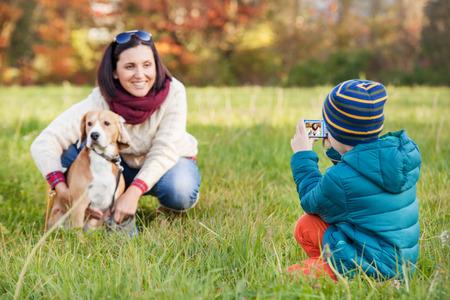 Little photographer - happy family moment photo