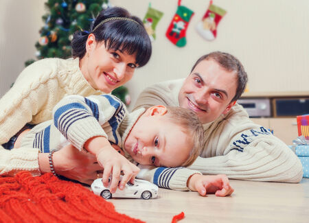 Family portrait at home under the christmas tree photo