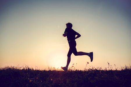 Running man silhouette in sunset time
