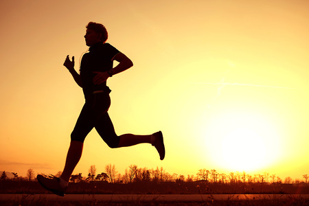 Silhouette runner in sunset rise