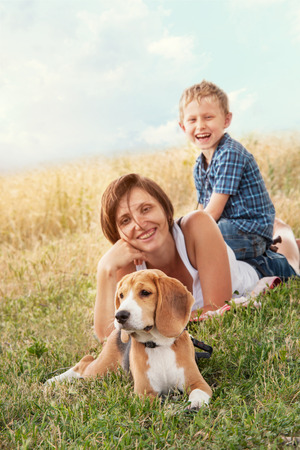 Family with dog have a calm leisure time outdoor photo