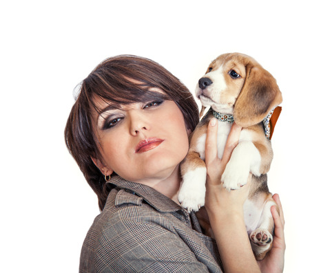 nurseling: Lady with cute beagle puppy Stock Photo