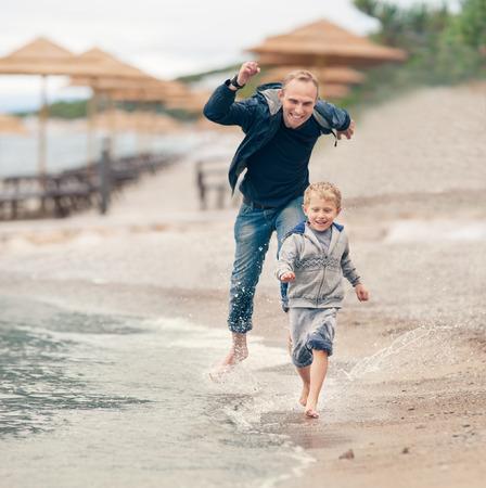 seacoast: My father just like a child! Happy family scene on the seacoast