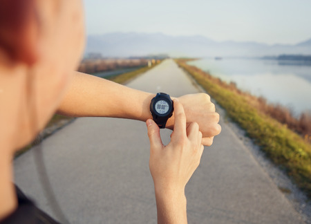 Runner start his watch before jogging Stock Photo