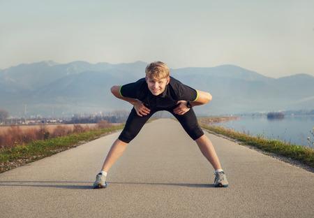 warming up: Man Warming up before running