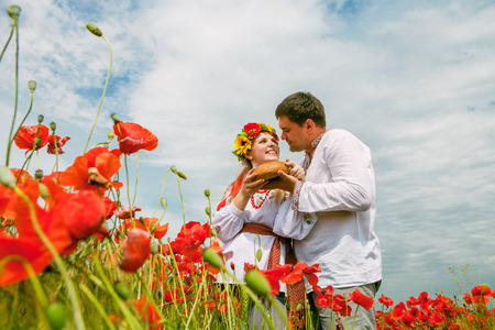 Happy ukrainian couple on the blossom field photo