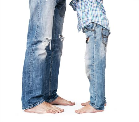 tattered: Son and father legs in tattered jeans