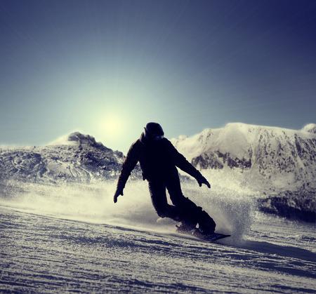 snowboarder: Snowboarder silhouette Stock Photo