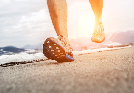 jogging track: Close up image runner legs in running shoes Stock Photo