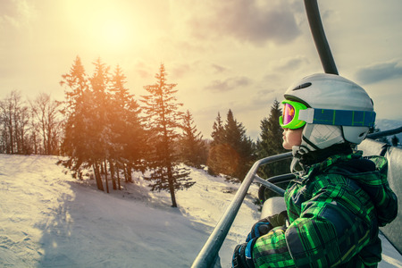 SKI: Little skier on the ski lift Stock Photo