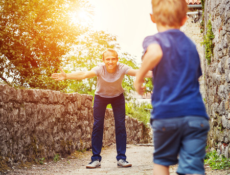 children running: Son runs  to his father hugs