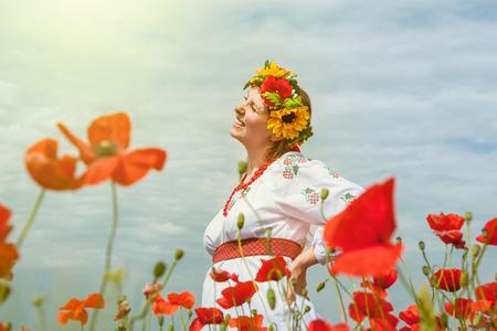 Happy smiling ukrainian woman among blossom field photo
