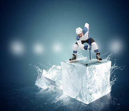 sportsmanship: Hockey player on the ice Cube - face-off moment Stock Photo