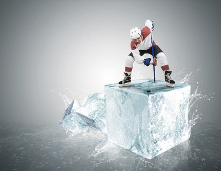 Ice hockey player on the ice cube during face-off photo